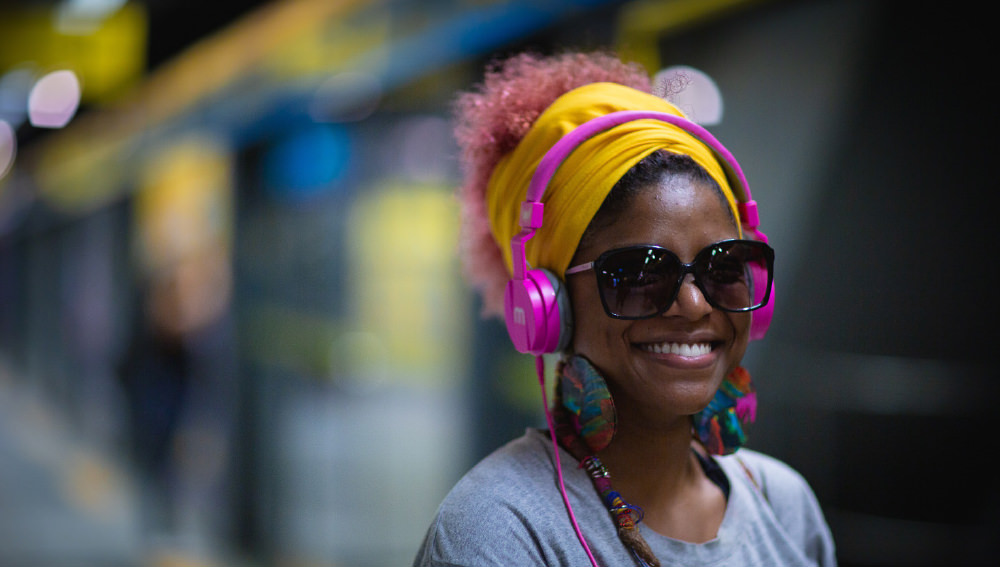 Woman listening to Broadstance Media production wearing headphones